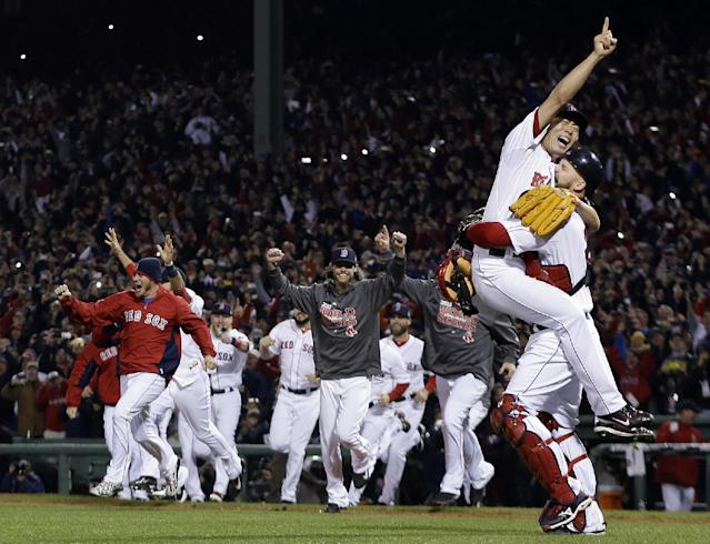 FILE - In this Oct. 30, 2013, file photo, Boston Red Sox relief pitcher Koji Uehara and catcher David Ross celebrate after getting St. Louis Cardinals' Matt Carpenter to strike out and end Game 6 of baseball's World Series in Boston. The Red Sox won 6-1 to win the series. (AP Photo/Matt Slocum, File)