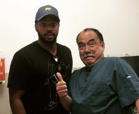 "Donald Faison, pictured with his doctor, got the ""snip, snip,"" according to his wife, CaCee Cobb. (Photo: CaCee Cobb via Instagram)"