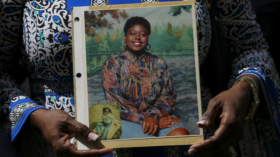 Antoinette Dorsey-James holds a picture of her sister Pamela Turner