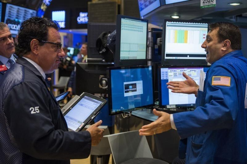 Traders work on the floor of the New York Stock Exchange shortly after the opening of the markets in New York