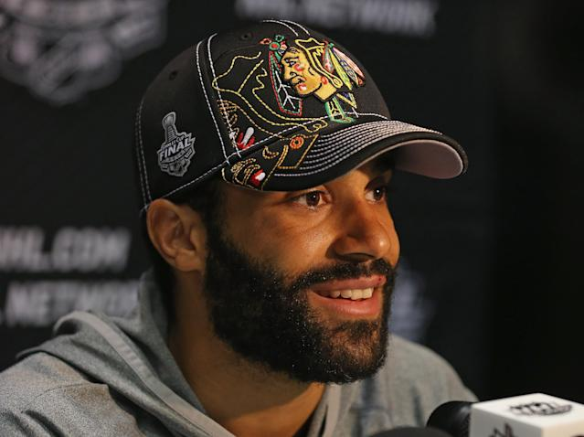 CHICAGO, IL - JUNE 11: Johnny Oduya #27 of the Chicago Blackhawks answers questions during the 2013 NHL Stanley Cup media day at the United Center on June 11, 2013 in Chicago, Illinois. (Photo by Jonathan Daniel/Getty Images)