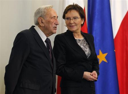 Ewa Kopacz, the newly elected speaker of the parliament, chats with former Prime Minister Tadeusz Mazowiecki at the Presidential Palace in Warsaw