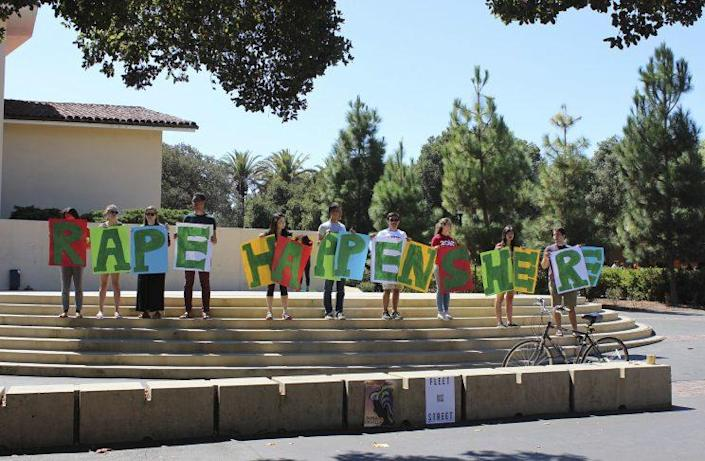 Students hold up a sign about rape during New Student Orientation on the Stanford University campus on Sept. 16, 2015. (Photo: Tessa Ormenyi / Associated Press)