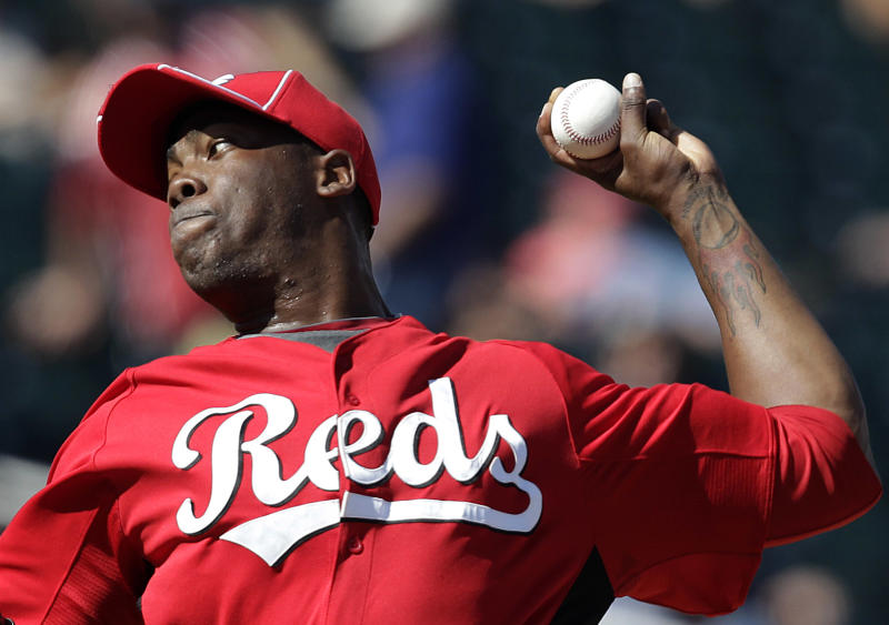 FILE - Cincinnati Reds relief pitcher Aroldis Chapman throws in the third inning of a spring training baseball game against the Cleveland Indians in Goodyear, Ariz., in this March 4, 2012 file photo. Chapman was hit in the face by a line drive Wednesday night March 19, 2014 and taken to a hospital with a cut above his left eye. (AP Photo/Jae C. Hong, File)
