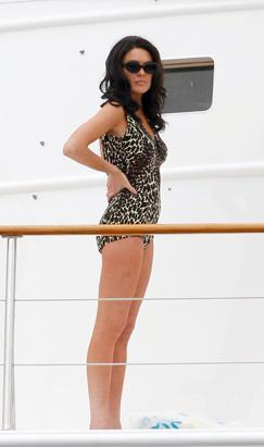 """Lindsay Lohan wears a leopard-print bikini on her first day of filming as Elizabeth Taylor in a new biopic. Lohan filmed a scene on a yacht for the Lifetime movie """"Liz and Dick"""", June 4, 2012"""