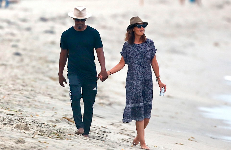 Jamie Foxx and Katie Holmes pictured together taking a romantic stroll on a beach in Malibu on Labor Day weekend in September 2017. Source: Backgrid