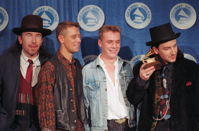 (Original Caption) Bono, lead singer of the Irish rock group, U2, holds one of the two Grammy Awards the group won 3/2 for Best Rock Group and Beat Album for their album, The Joshua Tree. The group gained a reputation for their music raising social issues.