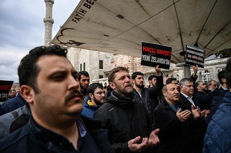 Protesters demonstrate to denounce the New Zealand mosque attacks at the Fatih mosque in Istanbul, after a symbolic funeral prayer for the victims of the attacks.