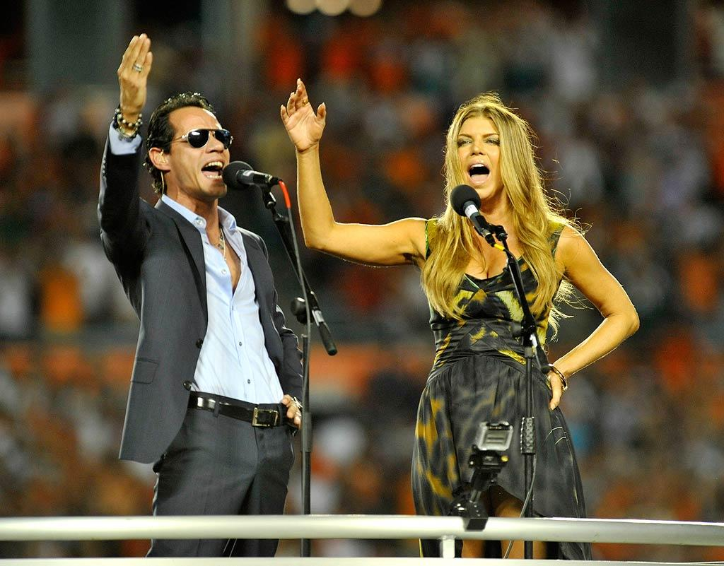 "Before the game -- where the Dolphins unfortunately lost to the Jets 31-23 -- Fergie and Jennifer's husband Marc Anthony performed the national anthem in front of a packed crowd. Kevin Mazur/<a href=""http://www.wireimage.com"" target=""new"">WireImage.com</a> - September 26, 2010"