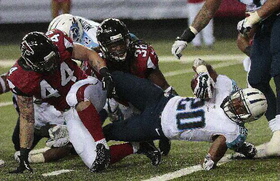Tennessee Titans running back Bishop Sankey (20) scores a touchdown against the Atlanta Falcons during the second half of an NFL preseason football game, Saturday, Aug. 23, 2014, in Atlanta. (AP Photo/John Bazemore)