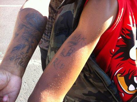 Chuntera Napier and her son Gaquan show off the tattoos. Would you let your 10-year-old get one?