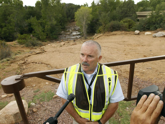 <p>Gila County Sheriff's Office Sgt. David Hornung briefs members of the media during a search and rescue operation for victims of a flash flood along the banks of the East Verde River, Sunday, July 16, 2017, in Payson, Ariz. </p>