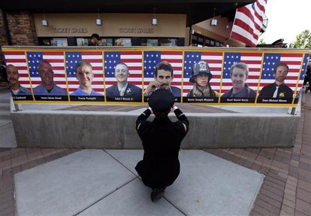 San Diego firefighter Bunsoldat takes a picture of each of the Prescott Fire Department's Granite Mountain Hotshots team from a banner that circles the entrance to their memorial in Prescott Valley
