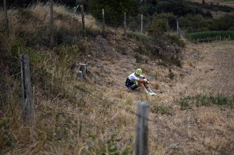 Team Wanty rider Belgiums Quinten Hermans sits in a field after falling during the first stage of the 72nd edition of the Criterium du Dauphine cycling race 2185 km between ClermontFerrand and SaintChristoenJarez on August 12 2020 Photo by AnneChristine POUJOULAT AFP Photo by ANNECHRISTINE POUJOULATAFP via Getty Images