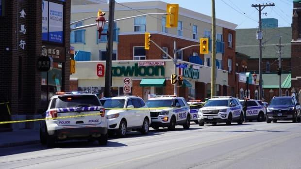 Ottawa police vehicles are parked on Somerset Street W., on April 23, 2021, following a pair of stabbings. One of the victims, 64-year-old Carl Reinboth, was later pronounced dead in hospital. (Jacques Corriveau/CBC - image credit)