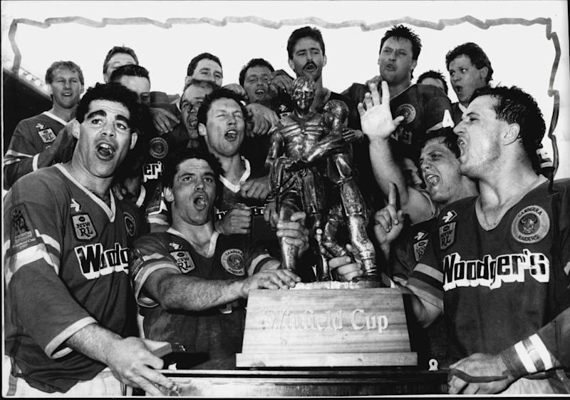 Canberra celebrating the 1989 Grand Final victory. (Photo by Paul Matthews; Craig Golding; Quentin Jones; Steve Christo/Fairfax Media via Getty Images).