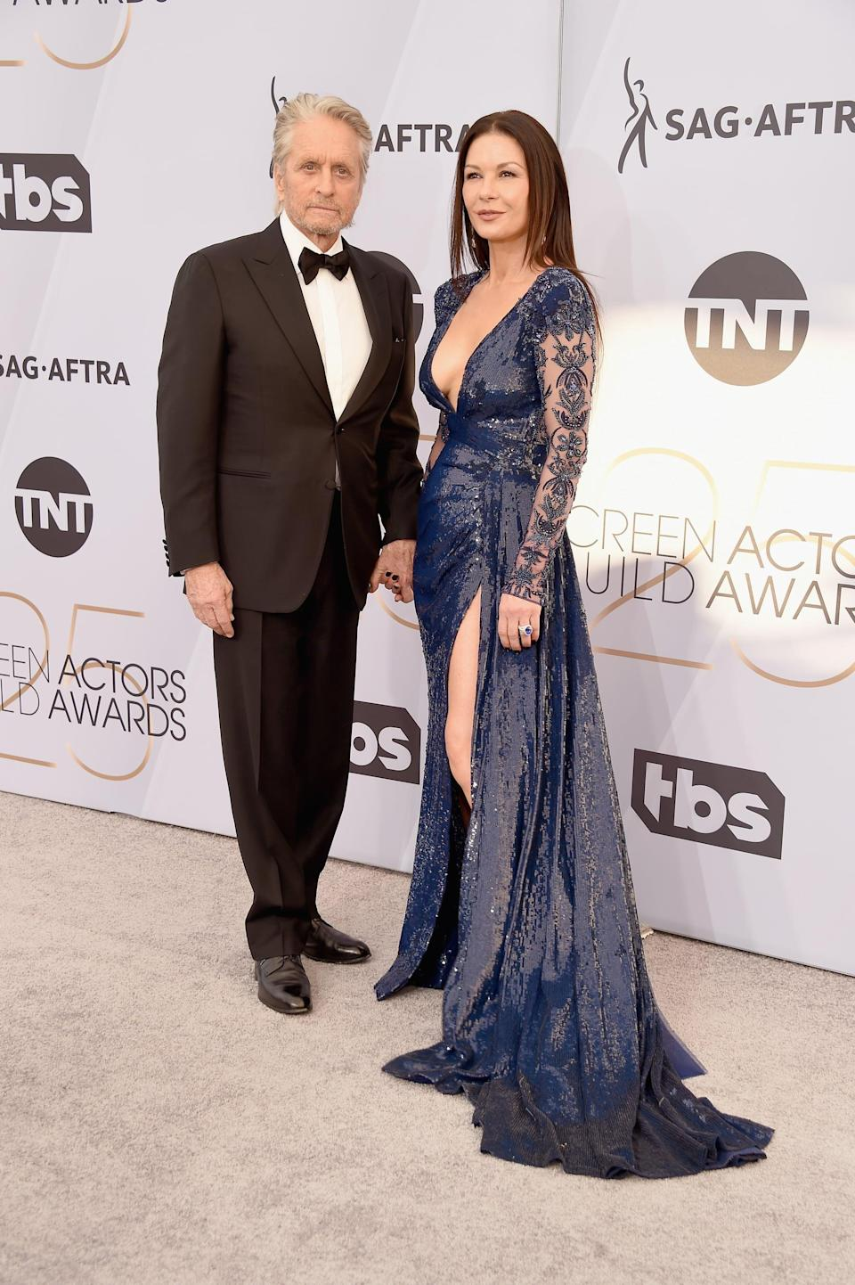 <p>Michael wearing a black suit. Catherine wearing a Zuhair Murad Couture gown and Chopard jewels.</p>