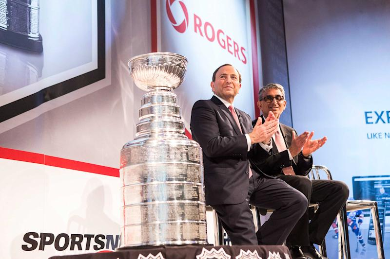 Rogers CEO Nadir Mohamed (right) sits with NHL Commissioner Gary Bettman at a news conference in Toronto on Tuesday 26, 2013