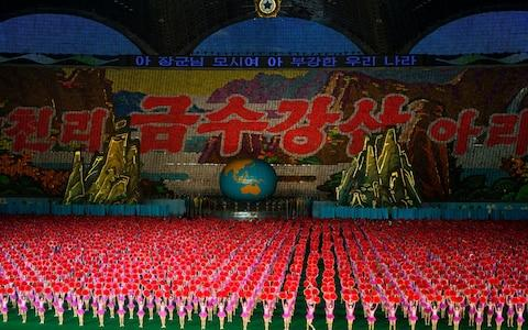 The Mass Games performed live in Pyongyang city of North Korea - Credit: Getty