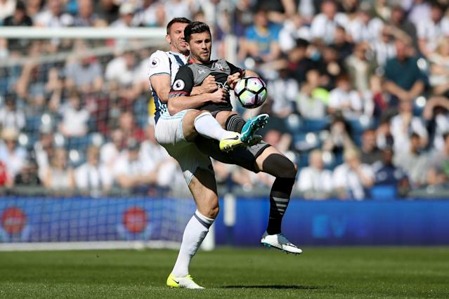 <p>West Bromwich Albion's Gareth McAuley (left) and Southampton's Shane Long battle for the ball</p>