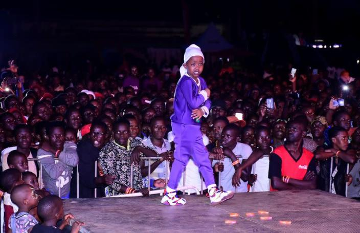 """Ugandan eight-year-old rapper """"Fresh Kid"""", whose real name is Patrick Ssenyonjo, performs during the """"Purple Party"""" show in Jinja"""