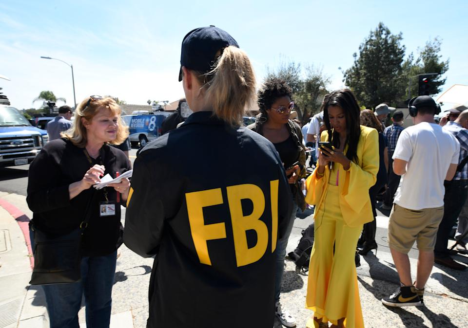 An FBI agent gives out information to members of the media outside of the Chabad of Poway Synagogue on Saturday. Source: AAP