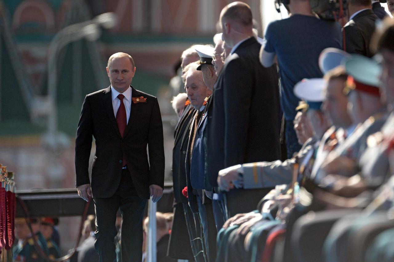 Russian President Vladimir Putin arrives to attend a Victory Day parade, which commemorates the 1945 defeat of Nazi Germany, in Moscow, Russia, Friday, May 9, 2014. Russia marked the Victory Day on May 9 holding a military parade at Red Square. (AP Photo/RIA-Novosti, Alexei Nikolsky, Presidential Press Service)