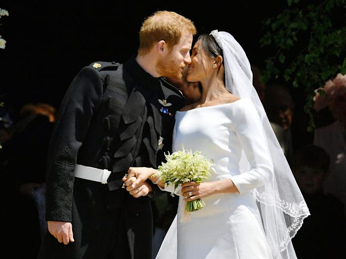 Prince Harry and Meghan Markle share a kiss at the royal wedding after their ceremony.