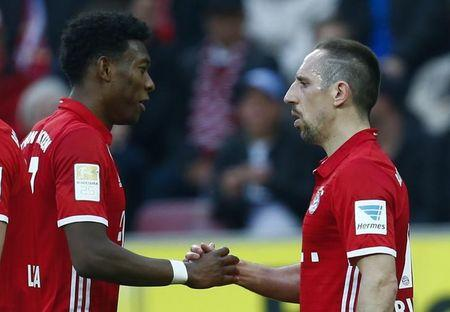 Football Soccer - FC Cologne v Bayern Munich - German Bundesliga - RheinEnergie stadium, Cologne, Germany - 04/03/17 - Bayern Munich's Franck Ribery of France (R) celebrates his goal against FC Cologne with fellow team mate David Alaba.       REUTERS/Ralph Orlowski