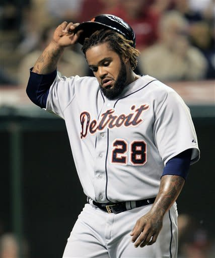 Detroit Tigers' Prince Fielder takes off his helmet after getting tagged out at home plate in the eighth inning in a baseball game against the Cleveland Indians, Wednesday, May 23, 2012, in Cleveland. The Indians won 4-2. (AP Photo/Tony Dejak)
