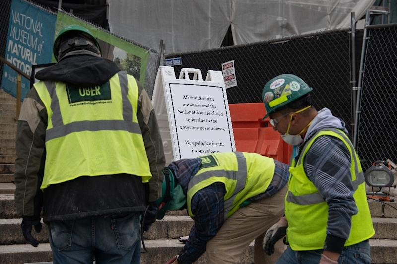 Renovation work continues at the National Museum of Natural History as a sign indicates that all Smithsonian museums are closed due to the government shutdown in Washington on January 8, 2019 (AFP Photo/NICHOLAS KAMM)