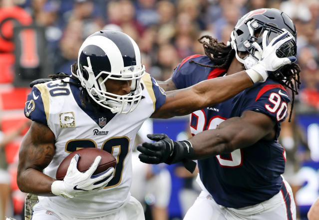 <p>Los Angeles Rams running back Todd Gurley pushes away Houston Texans outside linebacker Jadeveon Clowney during the first half of an NFL football game, Sunday, Nov. 12, 2017, in Los Angeles. (AP Photo/Alex Gallardo) </p>