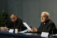 Mons. Filippo Iannone, right, and Mons. Juan Ignacio Arrieta Ochoa de Chinchetru hold a press conference to illustrate changes in the Church's Canon law, at the Vatican, Tuesday, June 1, 2021. Pope Francis has changed church law to explicitly criminalize the sexual abuse of adults by priests who abuse their authority and to say that laypeople who hold church office can be sanctioned for similar sex crimes. (AP Photo/Andrew Medichini)