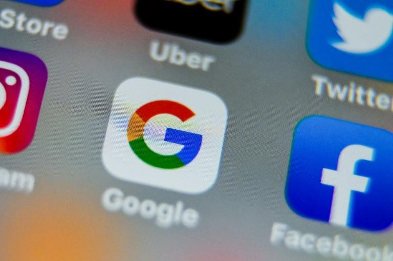 Facebook and Google are confronting antitrust investigations in the United States, a sign of growing concerns of the dominant position of big online platforms (AFP Photo/DENIS CHARLET)