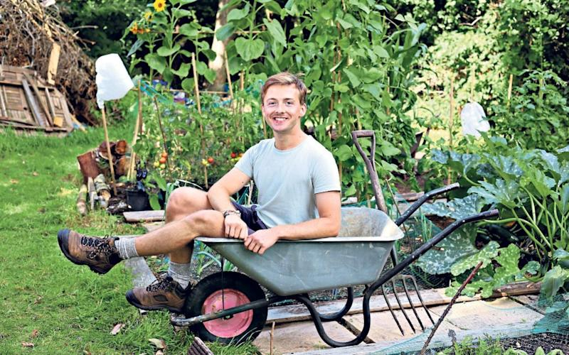 Sitting pretty: Nick Kroll in his garden at his parents home near Oxford - John Lawrence