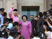 Then Malaysian Prime Minister Najib Razak, left in pink, waves with his wife Rosmah Mansor at prime minister's office in Putrajaya, outside Kuala Lumpur, Malaysia, on April 3, 2009. Najib was found guilty Tuesday, July 28, 2020 in his first corruption trial linked to one of the world's biggest financial scandals - the billion-dollar looting of the 1MDB state investment fund. (AP Photo)