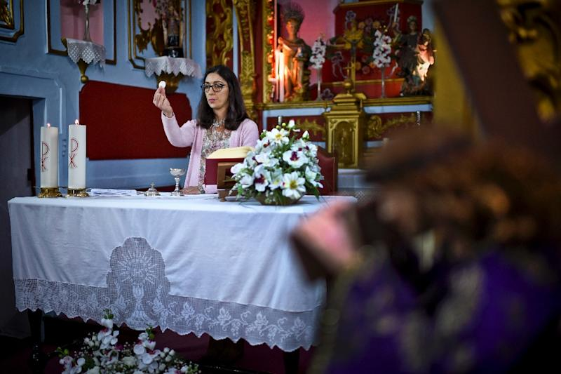 The practice of Sunday services being led by laypeople in a priest's absence take place in a number of countries, including Canada, France, Germany, the Netherlands, Portugal, Switzerland and the US (AFP Photo/PATRICIA DE MELO MOREIRA)