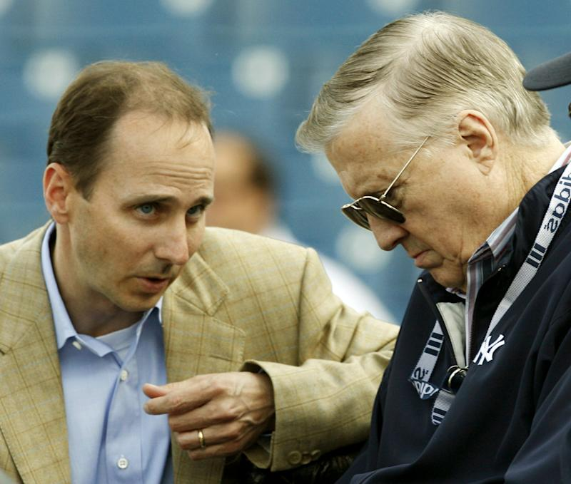 ** FILE ** New York Yankees general manager Brian Cashman, left, talks with principal owner George Steinbrenner, before the Yankees spring baseball game against the Boston Red Sox at Legends Field in Tampa, Fla., in this March 22, 2006 file photo. (AP Photo/Kathy Willens)