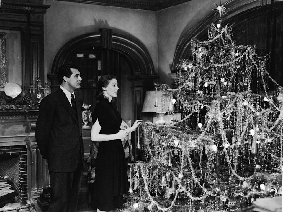 <p>Actor Cary Grant and actress Loretta Young admire a beautifully decorated Christmas tree on the set of their 1947 film,<em> The Bishop's Wife</em>. Filming was done in Minneapolis, Minnesota, and lyrics for the picture were recorded by Nat King Cole.</p>