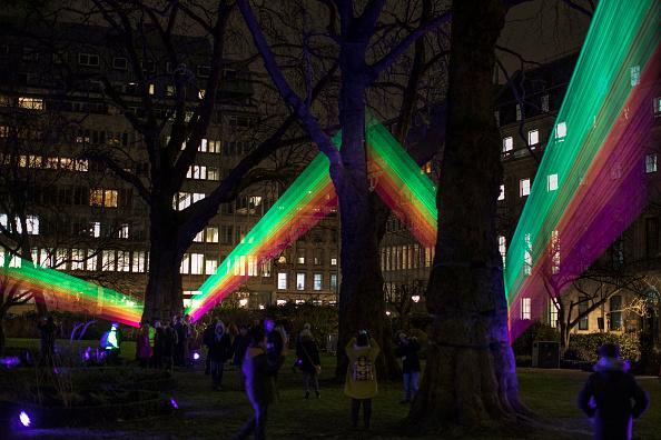 Members of the public look at 'Spectral'•, by Katarzyna Malejka and Joachim Slugocki in St James's Square during 'Lumiere London' festival of light 2018 on January 18, 2018 in London, England. Lumiere London is a four night long light festival spanning the British capital with more than 50 artworks by UK and international aritsts. (Photo by Dan Kitwood/Getty Images)