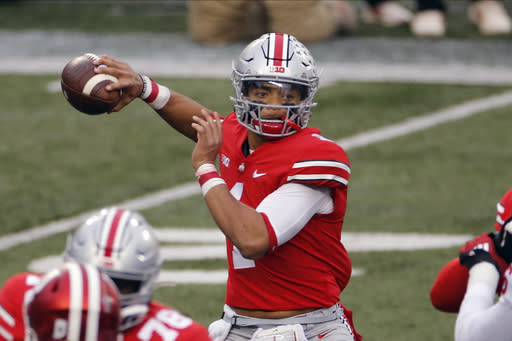 FILE - Ohio State quarterback Justin Fields throws a pass against Indiana during the first half of an NCAA college football game in Columbus, Ohio, in this Saturday, Nov. 21, 2020, file photo. Fields threw a Sugar Bowl-record six touchdown passes and accumulated 385 yards passing in the third-ranked Buckeyes 49-28 College Football Playoff semifinal victory over No. 2 Clemson. (AP Photo/Jay LaPrete, File)