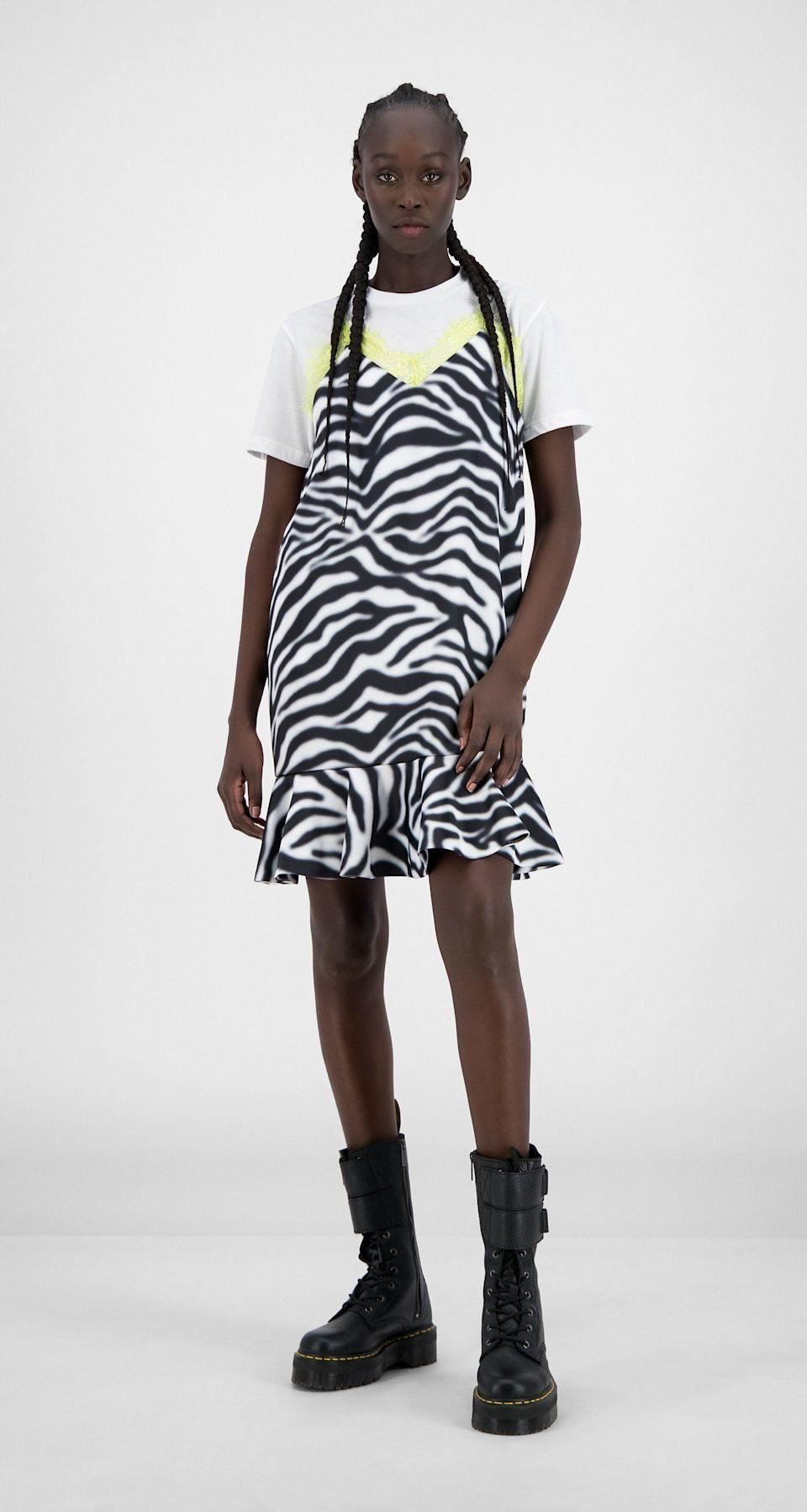 """<p><strong>Daily Paper</strong></p><p>dailypaperclothing.com</p><p><strong>103.00</strong></p><p><a href=""""https://www.dailypaperclothing.com/collections/women-all/products/zebra-sharp-green-heri-top?variant=31248388784262"""" rel=""""nofollow noopener"""" target=""""_blank"""" data-ylk=""""slk:Shop Now"""" class=""""link rapid-noclick-resp"""">Shop Now</a></p><p>A zebra-printed mini over a simple white tee is *chef's kiss*, but add some edgy (and rain-proof) combat boots to it and you're solid. </p>"""
