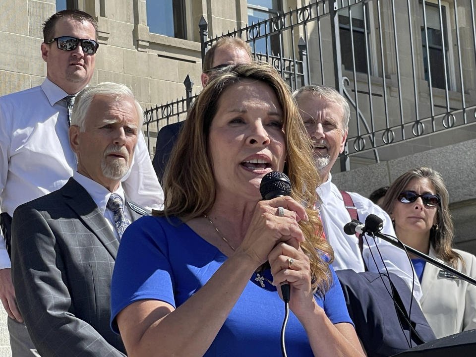 FILE - In this Sept. 15, 2021 file photo, Republican Lt. Gov. Janice McGeachin addresses a rally on the Statehouse steps in Boise, Idaho. McGeachin is a far-right Republican who is running for governor. This week she sought to activate the Idaho National Guard and send soldiers to the U.S.-Mexico border while Gov. Brad Little, also a Republican, was out of state. Mainstream Idaho Republicans concerned about a takeover by the surging far-right wing of the party are asking Democrats, Independents or other affiliated voters to register as Republicans to vote in the party's May primary. (AP Photo/Keith Ridler, File)