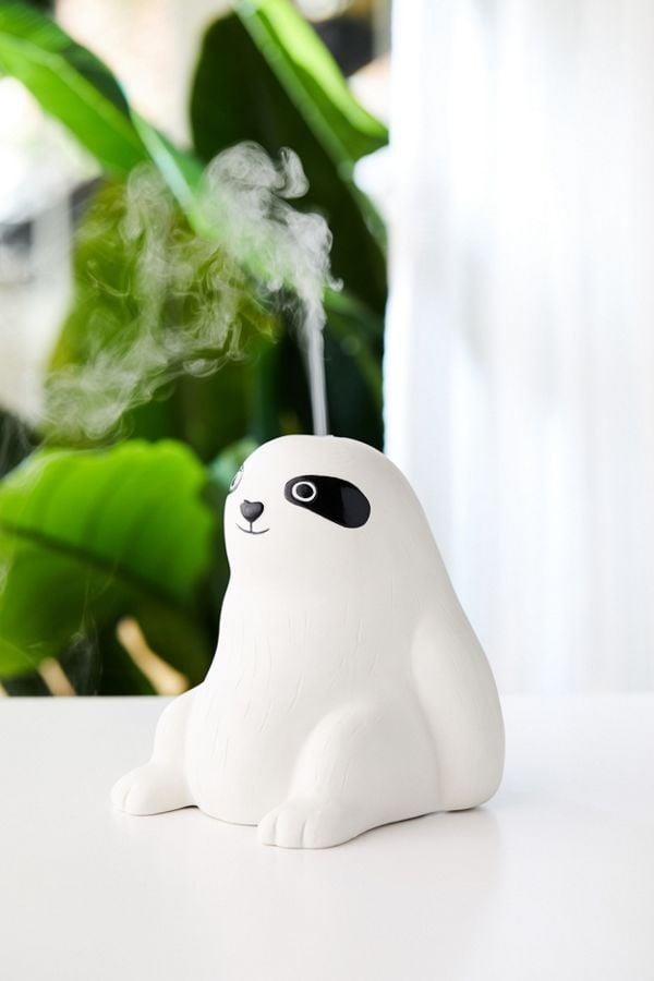 """<p><a href=""""https://www.popsugar.com/buy/Sloth-Essential-Oil-Diffuser-489424?p_name=Sloth%20Essential%20Oil%20Diffuser&retailer=urbanoutfitters.com&pid=489424&price=69&evar1=casa%3Aus&evar9=46600175&evar98=https%3A%2F%2Fwww.popsugar.com%2Fphoto-gallery%2F46600175%2Fimage%2F46600195%2FSloth-Essential-Oil-Diffuser&list1=urban%20outfitters%2Chome%20decor%2Cessential%20oils%2Csloth&prop13=api&pdata=1"""" rel=""""nofollow"""" data-shoppable-link=""""1"""" target=""""_blank"""" class=""""ga-track"""" data-ga-category=""""Related"""" data-ga-label=""""http://www.urbanoutfitters.com/shop/sloth-essential-oil-diffuser?category=wellness-products&amp;color=010&amp;type=REGULAR"""" data-ga-action=""""In-Line Links"""">Sloth Essential Oil Diffuser</a> ($69)</p>"""