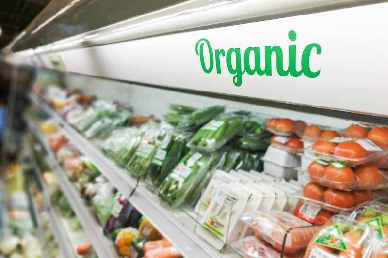 Organic packaged produce in a grocery aisle.