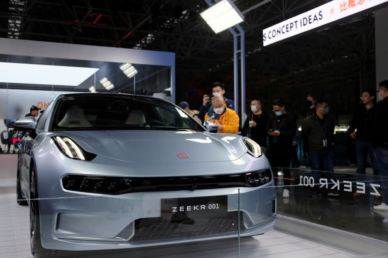 Visitors check a Zeekr 001, a model from Geely's new brand Zeekr, at its factory in Ningbo