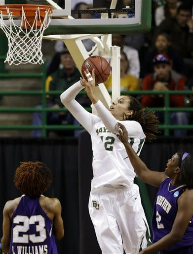 Baylor's Brittney Griner (42) shoots against Prairie View A&M's Latia Williams (23) and Shamiya Brooks, right, in the first half of a first-round game in the women's NCAA college basketball tournament, Sunday March 24, 2013, in Waco, Texas. (AP Photo/Tony Gutierrez)