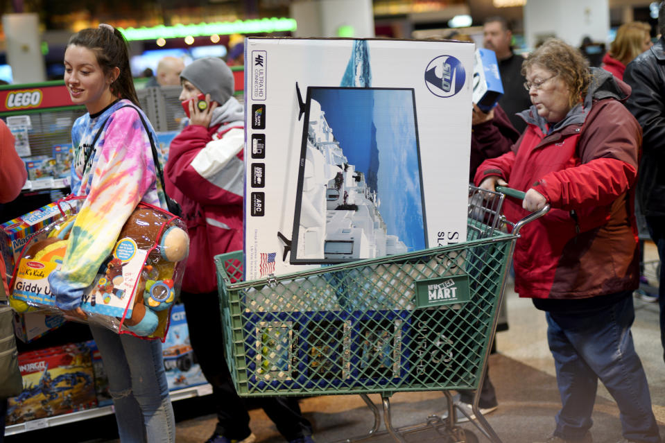 Black Friday shoppers wait in line to check out at the Nebraska Furniture Mart store in Omaha, Neb., Friday, Nov. 23, 2018. (AP Photo/Nati Harnik)