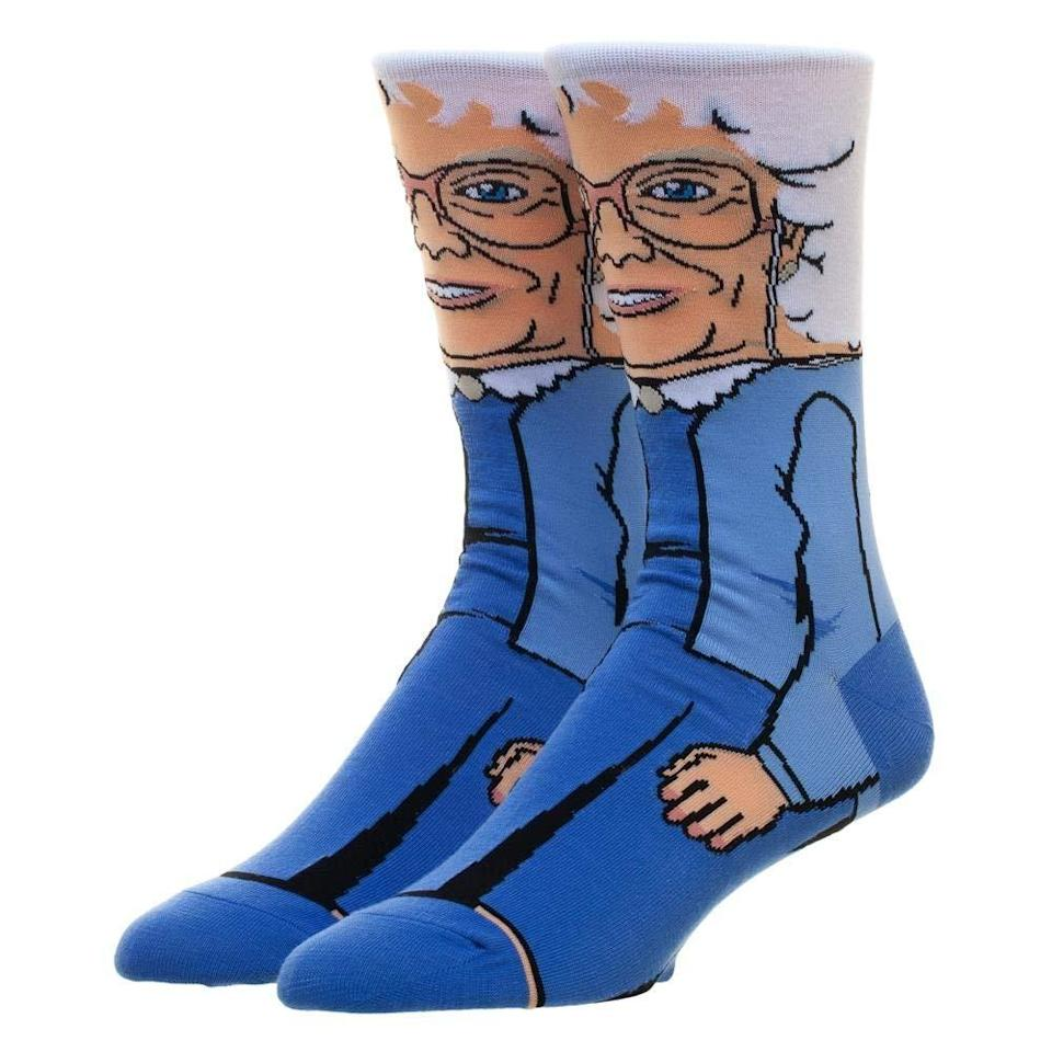 """Don't worry, Sophia isn't the only <em>Golden Girls</em> cast member available on socks — you can choose from <a href=""""https://www.amazon.com/dp/B07G3JHNZX/ref=cm_gf_aWE_i03_d_p0_c0_qd0___________________VGuQMP6XY56AZ7ukwpZl?th=1"""" rel=""""nofollow noopener"""" target=""""_blank"""" data-ylk=""""slk:Blanche"""" class=""""link rapid-noclick-resp"""">Blanche</a>, <a href=""""https://www.amazon.com/dp/B07GL1TPQK/ref=cm_gf_aWE_i03_d_p0_c0_qd0___________________VGuQMP6XY56AZ7ukwpZl?th=1"""" rel=""""nofollow noopener"""" target=""""_blank"""" data-ylk=""""slk:Dorothy"""" class=""""link rapid-noclick-resp"""">Dorothy</a>, or <a href=""""https://www.amazon.com/dp/B07G3K72JV/ref=cm_gf_aWE_i03_d_p0_c0_qd0___________________VGuQMP6XY56AZ7ukwpZl?th=1"""" rel=""""nofollow noopener"""" target=""""_blank"""" data-ylk=""""slk:Rose"""" class=""""link rapid-noclick-resp"""">Rose</a>, depending on your allegiances. <br><br><strong>Bioworld</strong> Golden Girls Socks, $, available at <a href=""""https://www.amazon.com/dp/B07GKZVT7K/ref=cm_gf_aWE_i03_d_p0_c0_qd0___________________VGuQMP6XY56AZ7ukwpZl"""" rel=""""nofollow noopener"""" target=""""_blank"""" data-ylk=""""slk:Amazon"""" class=""""link rapid-noclick-resp"""">Amazon</a>"""