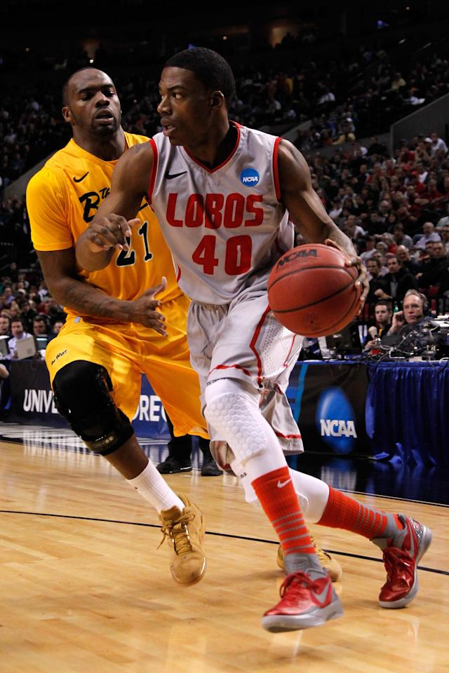 PORTLAND, OR - MARCH 15: Demetrius Walker #40 of the New Mexico Lobos drives on Larry Anderson #21 of the Long Beach State 49ers in the first half in the second round of the 2012 NCAA men's basketball tournament at Rose Garden Arena on March 15, 2012 in Portland, Oregon. (Photo by Jonathan Ferrey/Getty Images)